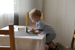 Toddler at dinner table Royalty Free Stock Photo