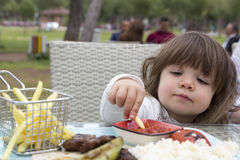 Toddler at dinner table Royalty Free Stock Photos