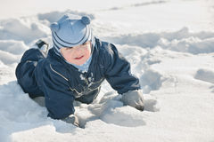 Toddler discovering snow Royalty Free Stock Images