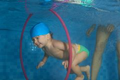 Toddler  dive in the hoop Royalty Free Stock Images