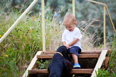 Toddler and dog Royalty Free Stock Images