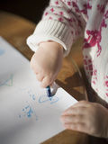 Toddler drawing. A toddler drawing with crayons on paper Royalty Free Stock Photos