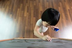 Toddler drawing on chalkboard. Little Asian child concentrate on drawing at the chalkboard Royalty Free Stock Image
