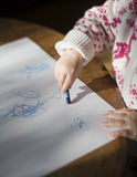 Toddler drawing with crayons. Toddler / young girl drawing with crayons Royalty Free Stock Photos