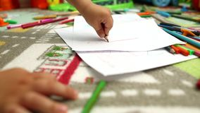 Toddler drawing with multiple colors stock footage