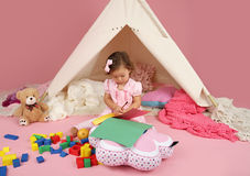 Toddler Drawing and Playing at Home. Toddler girl playing and drawing at home: indoor pretend play stock photography