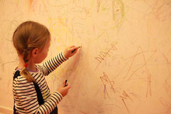 Toddler drawing on the wall Stock Image