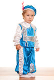 Toddler dressed in a suit of a prince Stock Photo