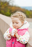 Toddler drinking juice. From straw stock images