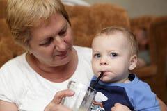 Toddler drinking smoothie Royalty Free Stock Image