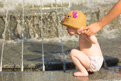 Toddler drinking from the water fountain Stock Photo