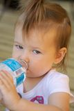 Toddler drinking water Royalty Free Stock Image