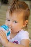 Toddler drinking water Royalty Free Stock Image