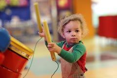 Toddler drumming Royalty Free Stock Photo
