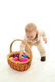 Toddler and easter eggs Stock Photography