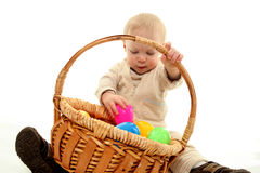 Toddler and easter eggs Stock Images