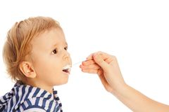 Toddler eat cottage cheese Royalty Free Stock Photography