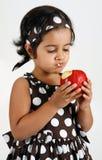 Toddler eating apple Stock Photos