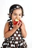 Toddler eating apple Royalty Free Stock Photos