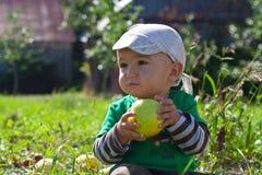 Toddler eating an apple Stock Image