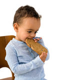 Toddler eating bread Royalty Free Stock Photography