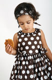 Toddler eating chocolate chip cookie Royalty Free Stock Photography