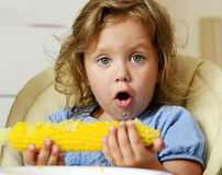 Toddler eating corn Royalty Free Stock Photography