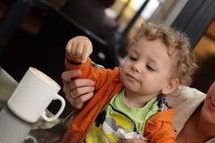 Toddler eating froth of coffee stock photography