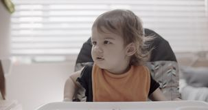 Toddler eating her dinner. Slow motion. Shot in 4K RAW on a cinema camera stock footage