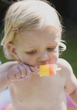 Toddler eating an ice lolly Royalty Free Stock Image