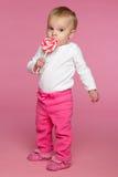 Toddler Eating Lolipop. Toddler girl eating lolipop candy Royalty Free Stock Images
