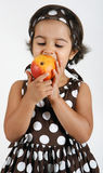 Toddler eating mango Stock Photos