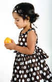 Toddler eating mango Stock Photos