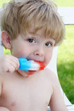 Toddler eating a popsicle Royalty Free Stock Image