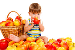 Toddler eating ripe apple Royalty Free Stock Photo