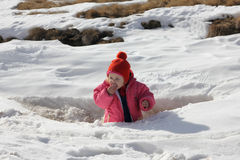 Toddler eating snow Stock Images