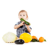 Toddler eating squash Stock Photography