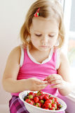 Toddler eating strawberry Royalty Free Stock Photos