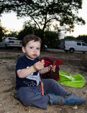 Toddler eating two hot dogs Royalty Free Stock Images