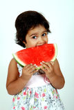 Toddler eating watermelon Royalty Free Stock Photos
