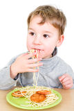 Toddler eats Pasta Stock Photo