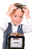 Toddler with an electricity meter. Little boy as an energy consultant with money and electricity meters Stock Photography