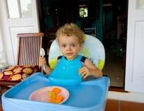 A toddler enjoying a tropical breakfast Stock Photo