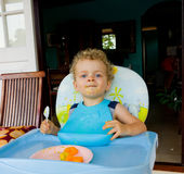 A toddler enjoying a tropical breakfast Royalty Free Stock Image