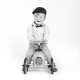 Toddler enjoys playing with his toy tractor Royalty Free Stock Photography