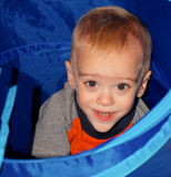 Toddler Explores Toy Tunnel royalty free stock photography