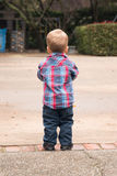 Toddler Facing Away Outside with a park in the background Stock Images