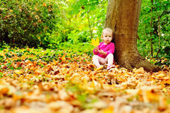 Toddler in fall forest Royalty Free Stock Photos