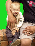 Toddler and father. Huge hand of the father protecting the child,magic wand default 32 to remove background Stock Images