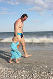 Toddler with father on the beach Stock Images